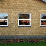 Topstyrede træ-alu vinduer udskiftet i et parcelhus