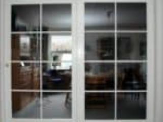 Billede af nye indvendige dobbeltdøre som skydedør med glas
